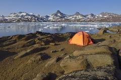 Campsite tent with view across Kong Oscars Havn Ammassalik Island Kalaallit - stock photo