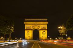 Triumphal Arch Arc de Triomphe at night trails of light Place Charles de Gaulle Stock Photos