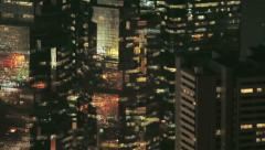 High density architecture - pan across skyscraper windows at night, Hong Kong - stock footage