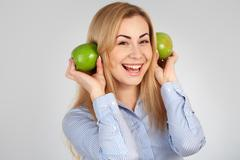 Healthy girl in diferent emotions, with green apple Stock Photos