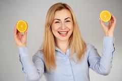 Healthy girl in diferent emotions, with orange - stock photo