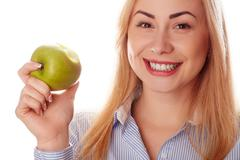 Healthy girl in diferent emotions, with green apple - stock photo