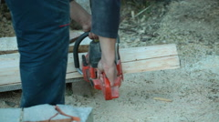 Carpenter carving wood using chain saw - stock footage