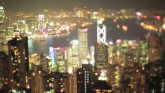 Magical night panning shot of Hong Kong filmed with a vintage tilt-shift lens - stock footage