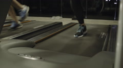 Group of adult women exercising on treadmill in gym - stock footage
