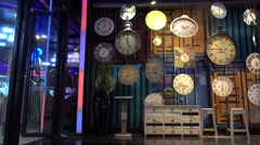 wall decorated by many clocks in shopping mall,time flies - stock footage