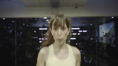 Adult women exercising on treadmill in gym - stock footage