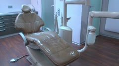 Dentist workplace. Dentist chair moving up Stock Footage
