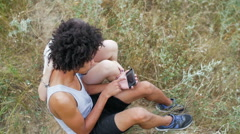 Young, beautiful, mixed racial couple has a rest at the sea Stock Footage