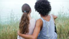 Attractive, athletic black guy hugging his pretty, beautiful girl on the beach - stock footage
