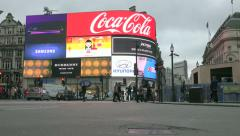 London Tilt up to reveal busy street scene at Picadilly Circus Stock Footage