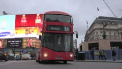 London Red Double Decker buses pass piccadilly circus slow camera pan Stock Footage