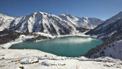 Time lapse of big lake in winter mountains , Big Almaty lake - stock footage