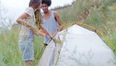 Young people are happy to rest on nature together - stock footage