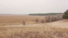 Stock Video Footage of woman comes to steppe her arms in nature open plain autumn