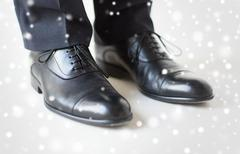 Close up of man legs in elegant shoes with laces Stock Photos