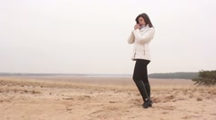 Stock Video Footage of woman girl autumn cold hands warm nature sand landscape steppe