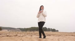 Stock Video Footage of woman girl autumn cold hands warm nature landscape sand  steppe