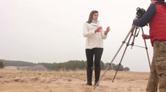 photographer  backstage woman girl man photographs the outside nature cold - stock footage