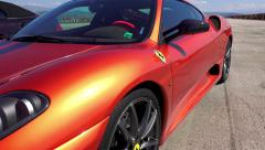 Ferrari sport car at Kondofrey drag race track, steadicam shot Stock Footage