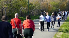 Slow motion Busy walkway Crowd of Sports Active People walking running cycling 6 Stock Footage
