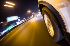 Car driving at night city Stock Photos