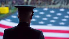 West Point Cadet Looking at Flag Stock Footage
