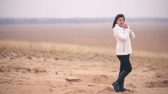 Stock Video Footage of woman cold It is in full growth nature girl Russia autumn steppe