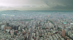Dramatic aerial time-lapse of tiny traffic in Taipei, Taiwan under stormy sky Stock Footage