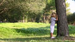 happy Little boy playing hide and seek - stock footage