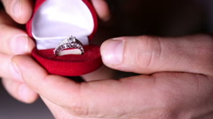 A man opens a box with a gold ring Stock Footage
