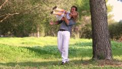 father and son playing hide and seek outdoors - stock footage