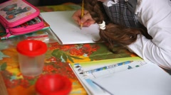 Stock Video Footage of unknown teen girl in class draw paints in an album drawing lesson School