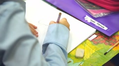 boy unknown draw class paints in album drawing lesson School - stock footage