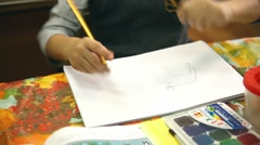 boy unknown paints draw class in album drawing lesson School - stock footage