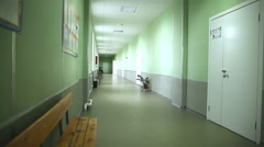 School empty corridor interior green wall to the right classes Stock Footage