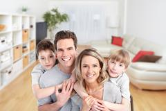 Happy family in a new house. Stock Photos