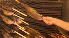 Grilled fish on a stick Stock Footage