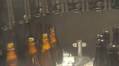 Bottles of beer on conveyor belt turning the corner Stock Footage