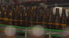 Bottles of beer on conveyor belt Stock Footage