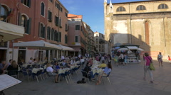 Relaxing in Campo Santo Stefano, Venice Stock Footage