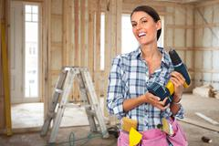Young woman with a drill. Stock Photos