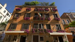 Orange building with flowers in Venice Stock Footage