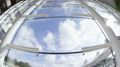 4K Distorted view of clouds moving across blue sky as seen through office window Stock Footage