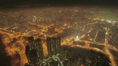 Beautiful aerial time-lapse of massive high-tech city at night Stock Footage