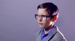 Stock Video Footage of boy teenager nerd portrait think the problem schoolboy glasses