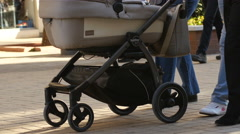Stock Video Footage of Walking rolling a stroller with a child in a pedestrian city center