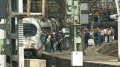 4K UHD Cologne Köln commuters on Main Train Station platform boarding ICE Stock Footage