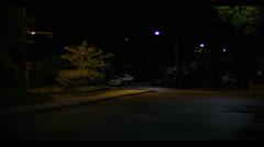 Suburban street neighbourhood corner at night Stock Footage