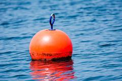 Stock Photo of Orange buoy